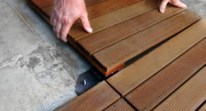 Deck tile installation the wood backed deck tiles are milled with four specifically designed ribbed pins for a secure fit simply set one of the tiles onto the pre installed ppazfo